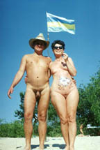 On a background of a flag of the Kiev Commonwealth of Naturists